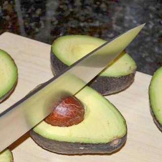 Pitting an avocado