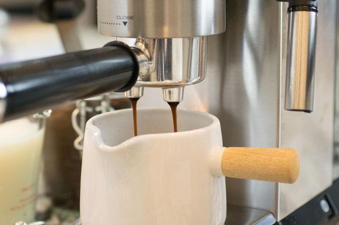 Espresso machine in action